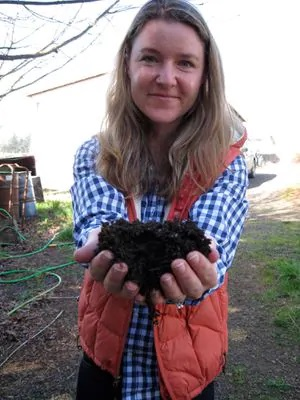 Winemaker Mimi Casteel with some of the compost she built for a healthy habitat for her microorganisms and robust topsoil at her Vineyard in Oregon's Willamette Valley